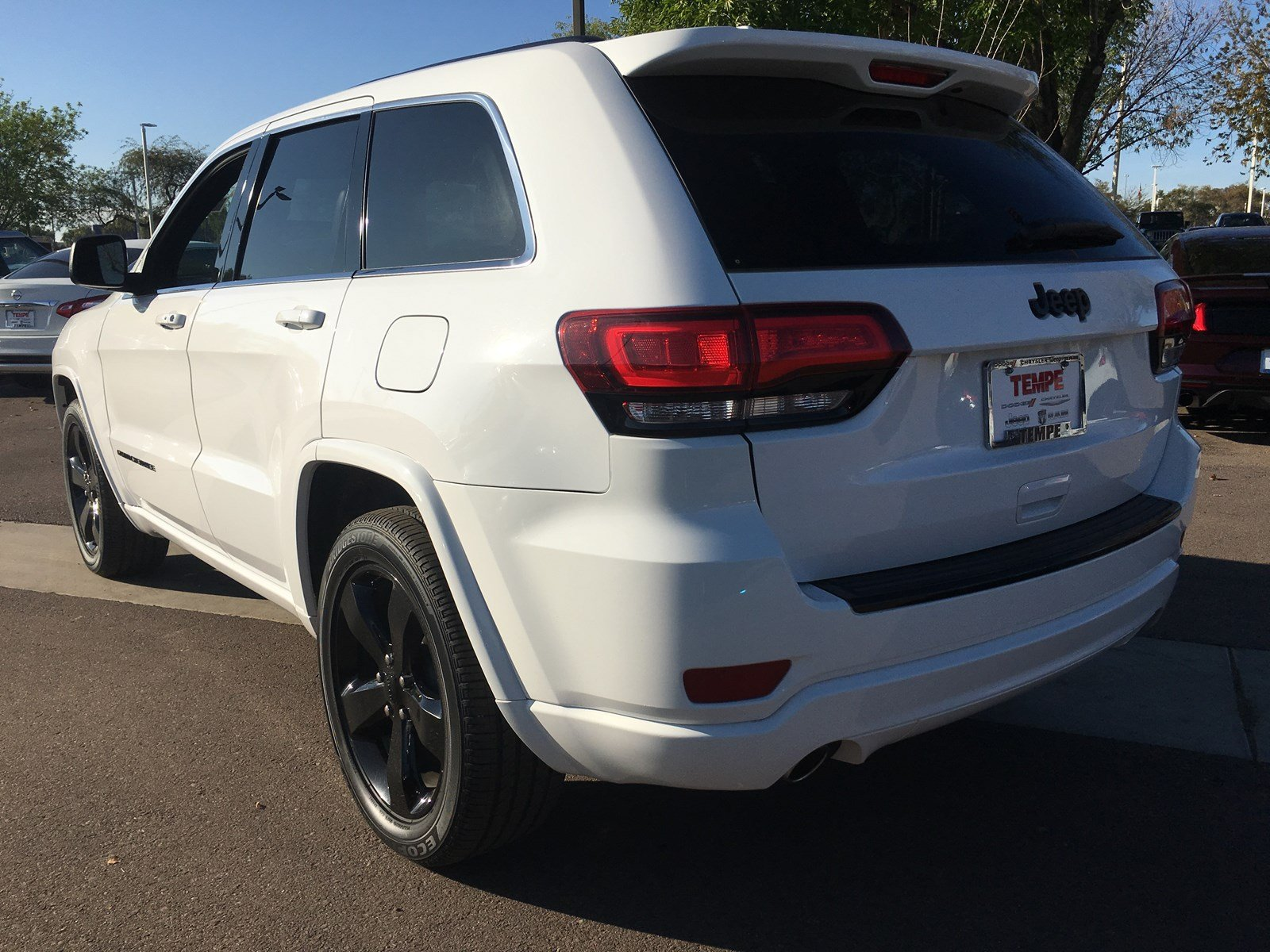 Pre-Owned 2015 Jeep Grand Cherokee Altitude RWD Sport Utility